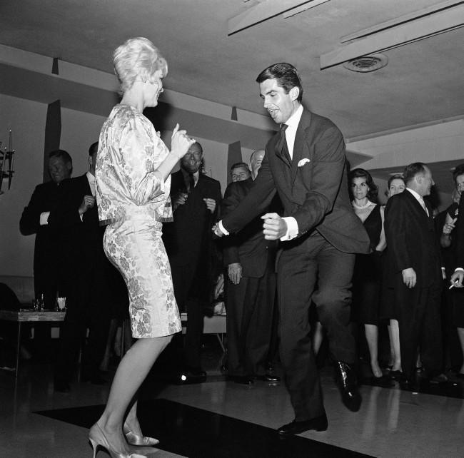 "Dorothy Provine of TV''s ""Roaring Twenties and TV actor George Hamilton do the twist at Romanoff's in Hollywood, March 22, 1962 where they were guests at a party given for Count Alberto Marone Cinzano of Turin, Italy. It started out as a sedate party but wound up with most of the guests doing the twist."