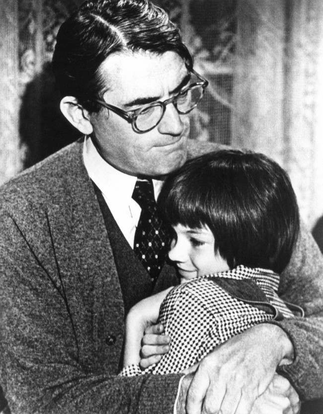 Gregory Peck embraces Mary Badham, 9, a Birmingham Alabama acting discovery who plays his daughter in To Kill a Mockingbird