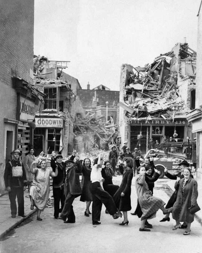 Residents of London's Lambeth walk doing the dance of the same name in London, Sept. 18, 1940 by way of showing their spirits are still high after bombs damaged the area.