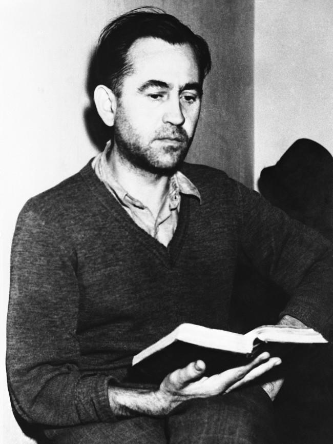 Friedrich Wilhelm Ruppert, camp commandant at the notorious concentration camp at Dachau between 1941 and 1945, reads in his prison cell, in Germany, on Oct. 27, 194,5 while awaiting his trial.