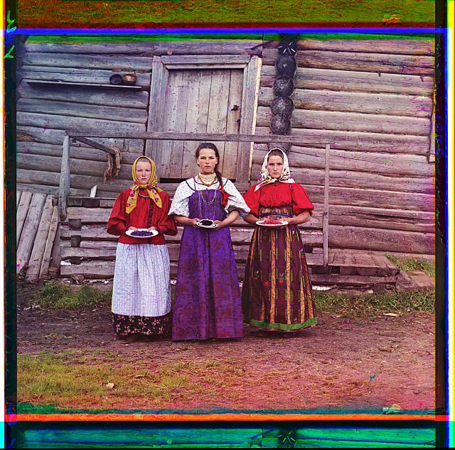 hree young women offer berries to visitors to their izba, a traditional wooden house, in a rural area along the Sheksna River, near the town of Kirillov.