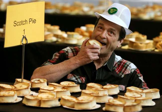 2013: Les McKeown, the one-time front man for Bay City Rollers judges the 15th World Scotch Pie Championship at Carnegie Conference Centre in Dunfermline. Picture by: Andrew Milligan/PA Wire/Press Association Images