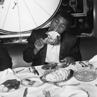 1966: Muhammad Ali Tucks Into A chicken at Isow''s Restaurant In Brewer Street, Soho, London