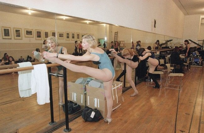"Radio City Music Hall Rockette Kiki Bennett stretches before the beginning of rehearsals for the ""Radio City Easter Show"" in New York on March 24, 1995. The troupe rehearsed such dance numbers as ""Happy Feet"" and ""Easter Parade.Â"