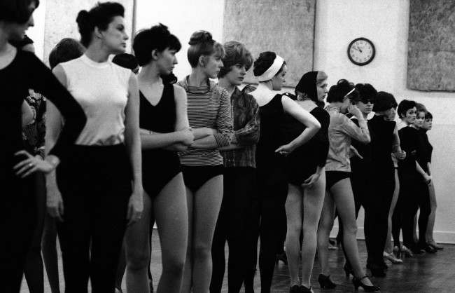 A group of Rockettes stands ready to start rehearsals for a new show on April 5, 1966. They rehearse new numbers even while their current show is still running. New shows are usually put together over a ten day period during which dance numbers are polished and new costumes made ready. The group puts on an average of ten different shows each year.