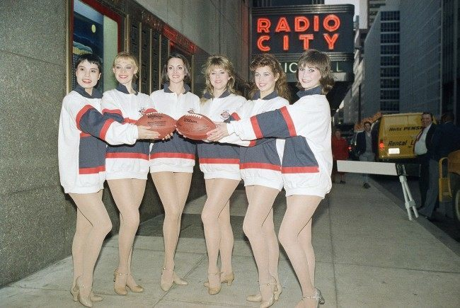 "Six members of Radio City Music Hall's Rockettes pose in New York on Dec. 23, 1987 preparing for their appearance at Super Bowl XXII on Jan. 31, 1988. From left, Setsuko Maruhashi, Susan Heart, Susanne Doris, Prudy Gray Demmler, Connie House, and Jereme Sheehan. Radio City Music Hall is producing the half-time show, to be called ""Something Grand!"""