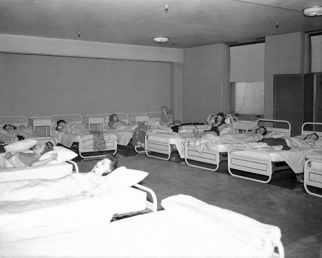 Stretching out for a catnap or rest in New York on March 26, 1946, these Rockettes are among the women performers who use the Music Hall's backstage dormitory. Equipped with 20 beds, with a nurse in attendance from the hospital staff, it is used mainly for resting between shows. But in rainy weather or on nights preceding early rehearsal, girls may stay all night.
