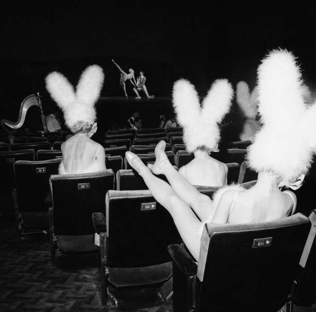 Bunny-eared Rockettes relax during a rehearsal of the current Easter show at New York's Radio City Music Hall on April 5, 1966. The Easter and Christmas shows are both highlights of the year at the Music Hall. Thousands line up to get – into the theater for the shows while they are on. Show time starts at 10 a.m. and continues for the Rockettes until after 10 p.m. at night. When the last show of the day is done. The film which accompanies the show keeps the audience in their seats in the giant 6,200-seat hall until nearly midnight.