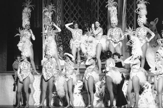 Some of the Radio City Music Hall Rockettes prepare themselves for a dress rehearsal in New York on March 2, 1978. Later in the day they put on the first performance of their annual Easter Show. If the entertainment palace closes as scheduled on April 12, this Easter's gala could be the Music Hall's last.