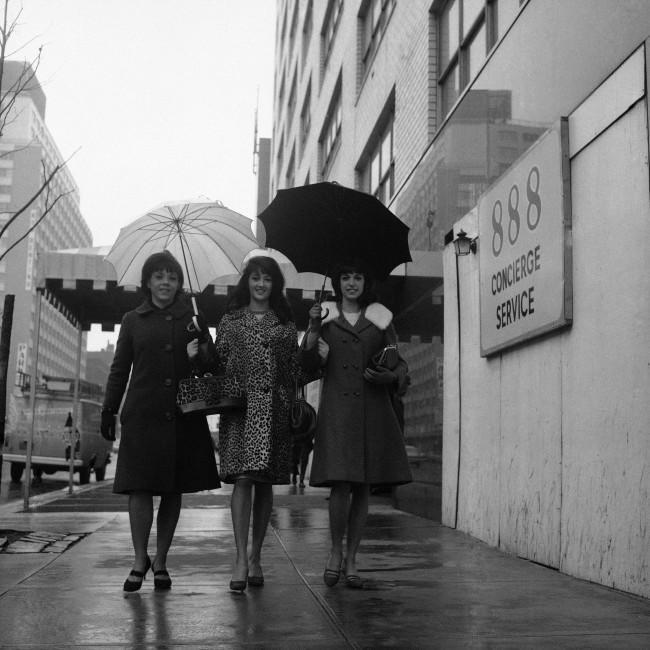 Three Rockettes walk to work for an early morning rehearsal in New York on April 5, 1966. Many of the girls share apartments to cut costs. Rockettes are recruited from among girls with dancing talent from high schools and colleges throughout the U.S. and Canada. Some of the girls come to New York from other countries to try out for the troupe. These three are, left to right: Karen Knowles of Bangor, Me., Verna Pharo of Barnegat, N.J. and Delores Heiner of Bennington, Vt.