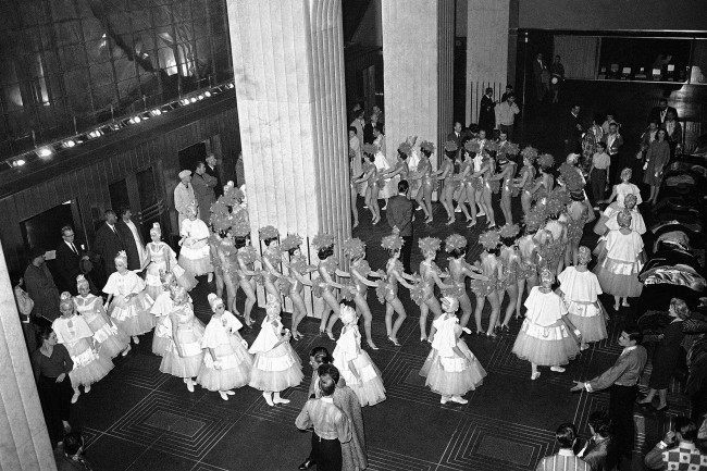A last minute run-through of their routine is held by the Radio City Music Hall Rockettes in the lobby of the RCA Building before going outside for taping of their part in the TV color special made in Rockefeller Center in New York on April 12, 1962. This section of the show was taped in the middle of the night, starting at 2 a.m.