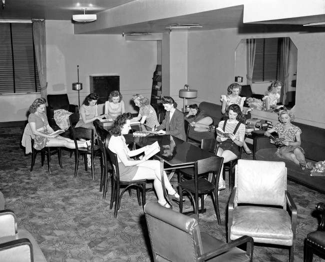 Some of the backstage activities. Some of the Rockettes relax in the library-lounge backstage at Radio City Music Hall in New York on March 26, 1946. They use it for reading, studying, letter-writing, and lounging. There is a circulating libra
