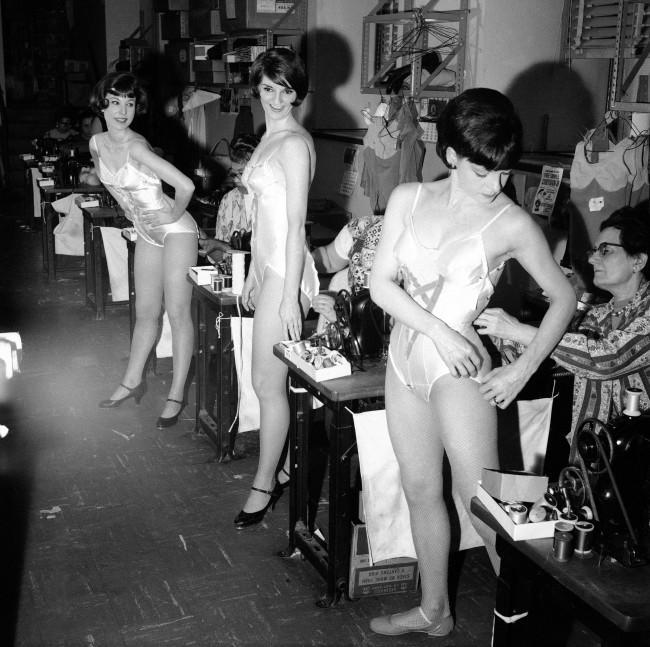 Left to right are Louise Thompson of Long Beach, Calif., Judy Little of Camden, N.J., and Joyce Hector of West Orange, N.J., fitted for costumes for a new show in the Radio City Music Hall's costuming department in New York on April 5, 1966. Fittings are sandwiched into periods between rehearsals and performances.