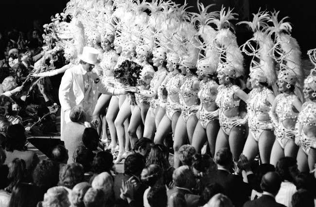 Flowers are handed out both from the audience and by top-hatted man to the Rockettes of New York's Radio City Music Hall on April 12, 1978 after the dancers completed their final scheduled performance in the venerable theater.