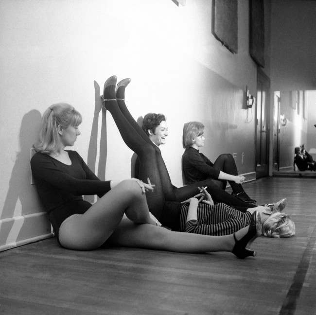 Four members of New York City's Radio City Music Hall Rockettes precision dance team take a break during rehearsals for a new show on April 5, 1966. The work is hard and the hours long for the girls who make the troupe. There are 46 girls in the troupe. These four, left to right, are Jane Simpson of Bangor, Mo., Jeanne Carroll of Hawthorne, N.Y., Susan Boron of Niles, Ohio and Diane McDonald of Union, N.J.