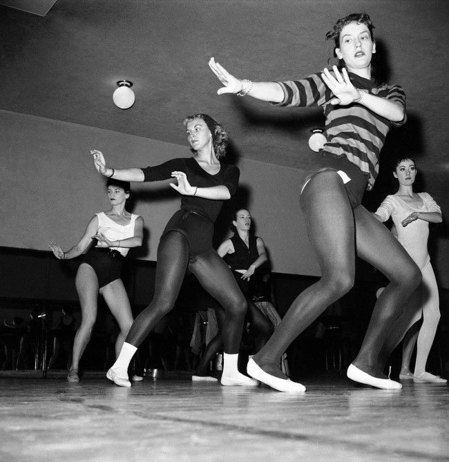 Thirty-six girls, dancing as one on the huge stage of New York's Radio City Music Hall on Oct. 15, 1958, are the envy of many other girls throughout the United States. The dancers are the celebrated Rockettes. One of the dancers, Mary Ann Strilka of Olyphant, Pa., in a black leotard, white ballet slippers and socks is caught by the camera in some of the behind-the-scenes work at the theater.