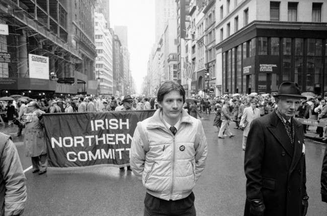 "Sean Sands, center, brother of IRA hunger striker Bobby Sands, marching in the New York parade up Fifth Avenue on March 17, 1982 with the contingent from the Irish Northern Aid Committee of New York. The button on his jacket says, ""England Get Out of Ireland."" (AP Photo/Warren Jorgensen) Ref #: PA.10419417  Date: 17/03/1982"