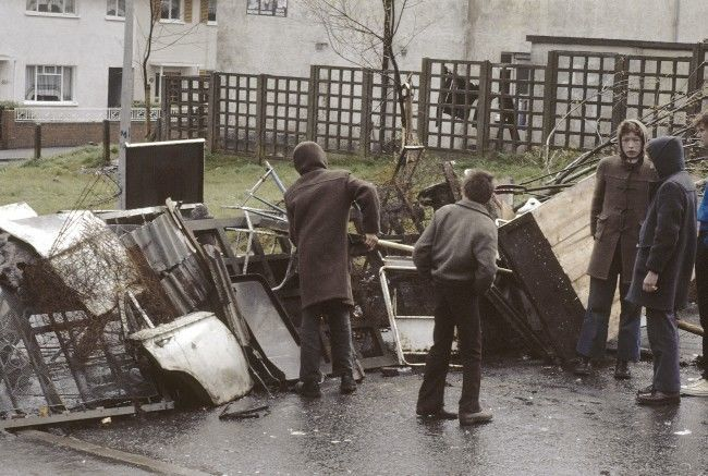 Local residents erect a barricade across the road in the Turf Lodge area of Belfast, Northern Ireland on April 30, 1981, during preparations for possible civil disorders, which are expected to follow the imminent death of IRA hunger striker Bobby Sands. Sands is into the 61st day of a hunger strike in Northern Ireland's Maze Prison. (AP Photo/Peter Kemp) Ref #: PA.10424388  Date: 30/04/1981