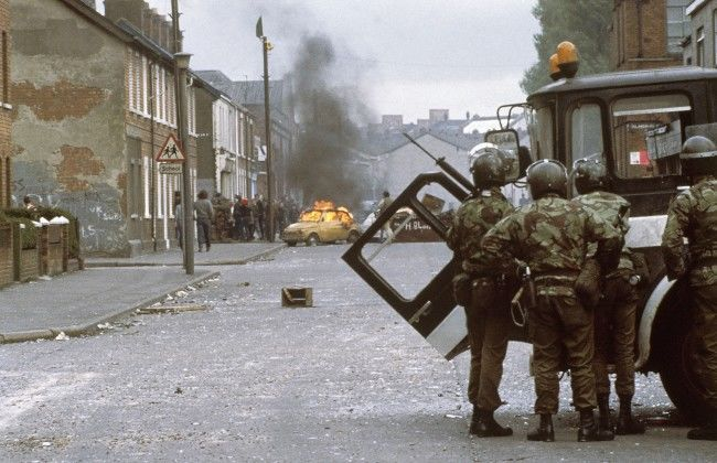 British troops (in foreground) clash with demonstrators in a Catholic-dominated area of Belfast, Northern Ireland's troubled capital city on May 5, 1981. Demonstrators returned to the streets in force, armed with petrol and acid bombs, following the death of Irish Republican Army hunger striker Bobby Sands.