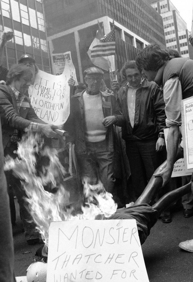 Demonstrators outside the British Consulate to the U.N. in New York on May 2, 1981, burn British Prime Minister Thatcher in effigy using a mannequin during a demonstration in support of hunger striker Bobby Sands, who is reported close to death in Northern Ireland's Maze Prison. The demonstration was organized by an organization called Irish Northern. (AP Photo/Kneisel)