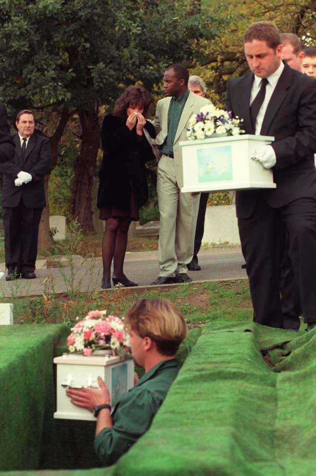 PA NEWS PHOTO 14/10/96 265491-18 Mandy Allwood comforted by her partner Paul Hudson as she watches the burial of her eight unborn babies during their funeral procession in West Norwood Cemetery, London Ref #: PA.1064799  Date: 14/10/1996