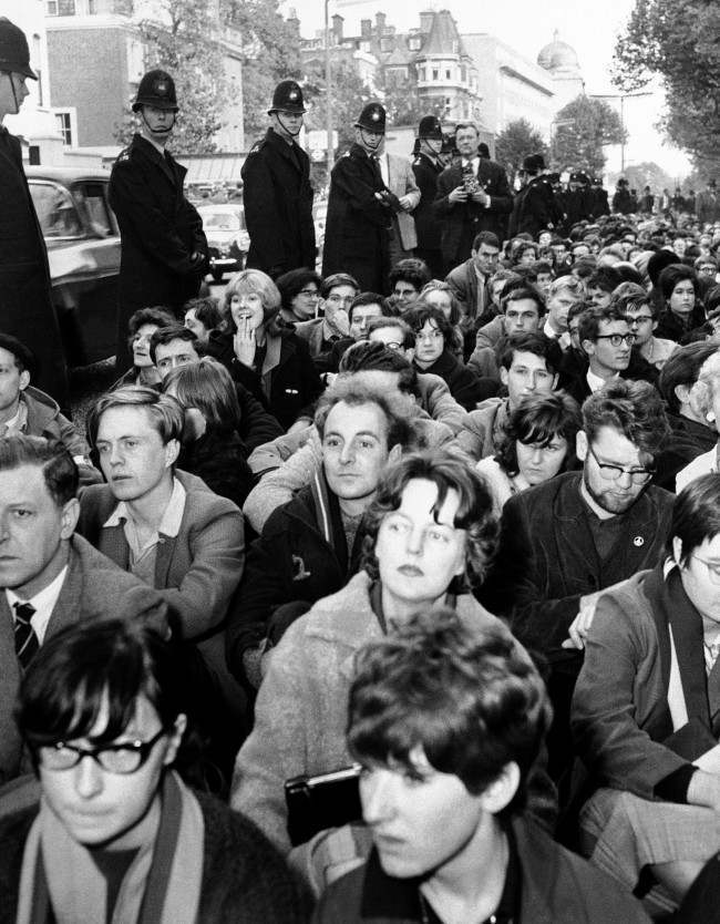Police line bayswater road in London on Oct. 21, 1961, alongside squatting ban-the-bomb demonstrators near the soviet embassy.