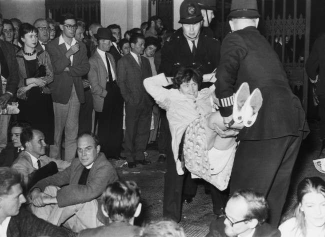 A demonstrator lets himself go limp as police officers carry him from Trafalgar Square, London, United Kingdom on Sept. 17, 1961 to a waiting van during the mass ban-the-bomb rally.