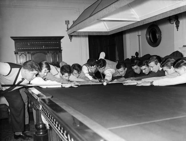 nooker - The B.A and C.C Young 16 to 18 Snooker Championship of Great Britain - Burroughs and Watts Match Hall Left to right; David Bend, David Bond, Terence Clarke, Ian Corbett, Paul Daverill, John Findlay, Stuart Goss, James McAllister, David Boots, John Shepherd, Beresford Tanner, and Geoffrey Thompson, posing with the white ball. Ref #: PA.10813438  Date: 16/12/1958