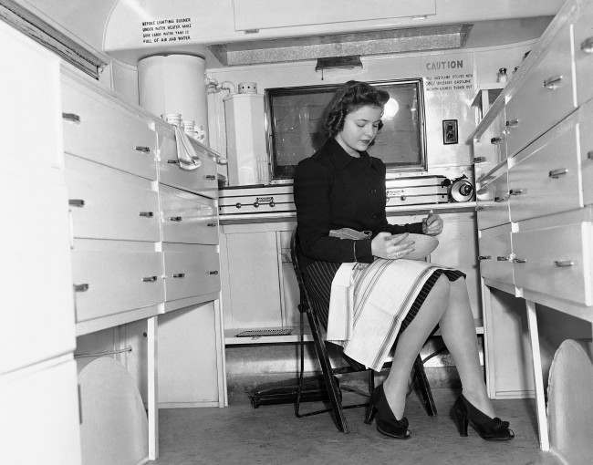 A woman works in a mobile Kitchen, Feb. 15, 1941.