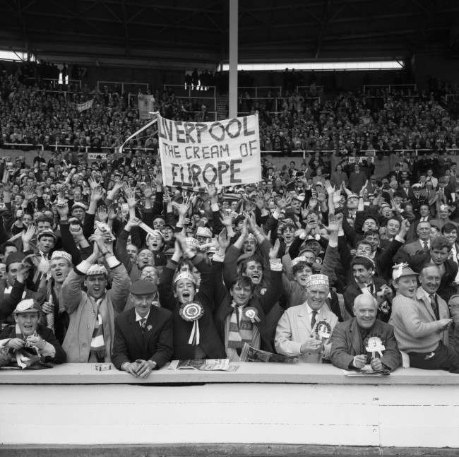 Liverpool fans show their support for their team who went on to win the match 2-1. Flag reads 'Liverpool the cream of Europe'.