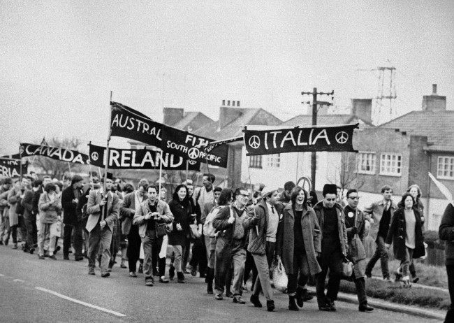Foreign groups (from Italy, Fiji, Australia, Canada and Algeria) are in the column of marchers as some 10,000 supporters of the Campaign for Nuclear Disarmament set out from Reading, Berkshire on April 21, 1962, on the second leg of their protest march from Aldermaston to London. The ban-the-bomb demonstrators spent the night under canvas outside Reading.