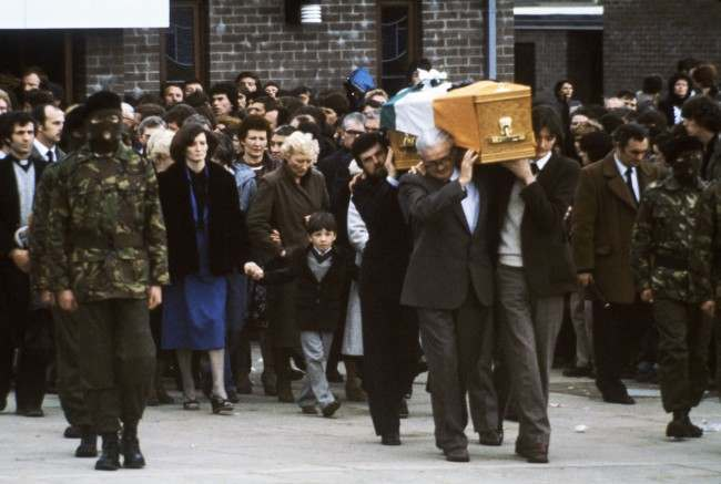 Escorted by hooded members of the Irish Republican Army, the coffin of hunger striker Bobby Sands leaves a church in Belfast, Northern Ireland on May 7, 1981, followed by his sister Marcella and his 7-year-old son Gerald.