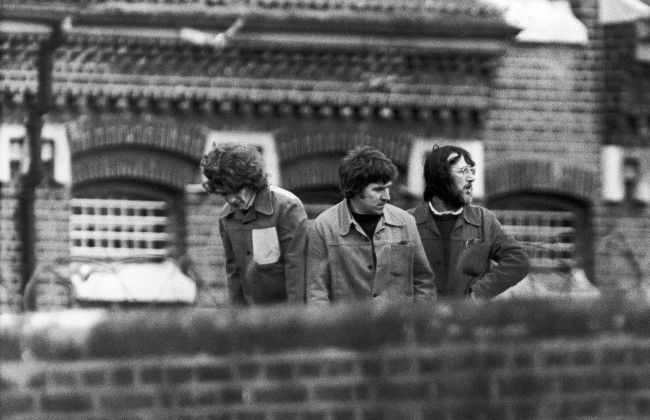 Three prisoners staging a protest on the roof of Wormwood Scrubs jail in London on April 26, 1981. They climbed onto the roof during an exercise period and began yelling slogans about IRA hunger striker Bobby Sands. (AP Photo) Date: 26/04/1981