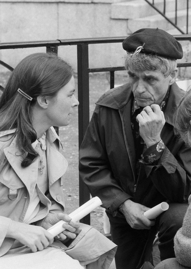 "Political activist Daniel Berrigan chats with Sister Rosaleen O'Halloran in New York on April 30, 1981, she is on a hunger strike in support of caparisoned IRA guerrilla Bobby Sands, during a rally at the United Nations in support of Sands. Sands were reported ""deteriorating at an alarming rate,"" and his mother has promised to let him die of starvation rather than compromise. (AP Photo/Nancy Kaye) Ref #: PA.11927523  Date: 30/04/1981"