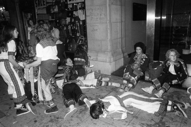 Young fans cool off outside the New Victoria Theatre in London, where teenagers went wild during a concert by the Bay City Rollers. At least 210 hysterical fans were treated for minor cuts and bruises, after flattening the first three rows of seats. PA/PA Archive/Press Association Images
