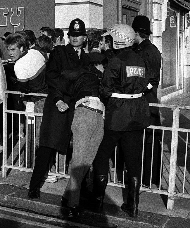OLLOWING YESTERDAY'S FOOTBALL VIOLENCE, POLICE ESCORT SOME OF THE 8,000 CHELSEA FANS TO WAITING COACHES AND HOVE RAILWAY STATION. Date: 04/09/1983