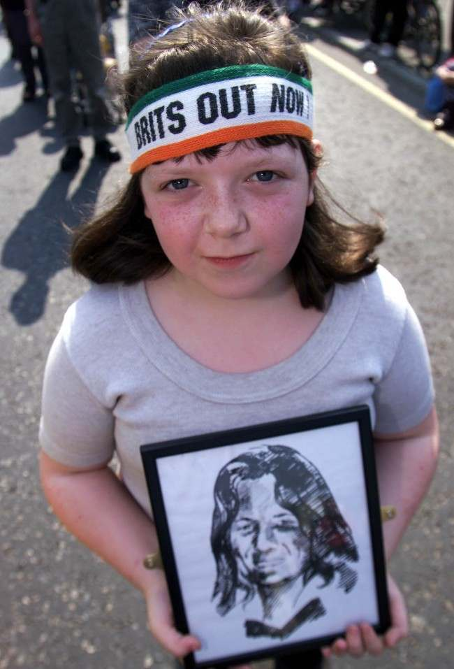 "Siobhan Quinn aged 12 from Belfast wearing a"" Brits out Now "" headband and carrying a drawing of Bobby Sands the first IRA hunger striker to die, at the19th Anniversary of the IRA Hunger strike. Gerry Adams addressed thousands of republicans later at Dunville park. *.. on the Falls road.  Ref #: PA.1296463  Date: 07/05/2000"