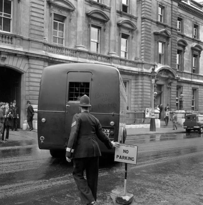 """Ban-the-Bomb"" is written inn the dust on the back of the Metropolitan Police Black maria van, believed to be carrying members of the the anti-nuclear Committee of 100 after they had received jail sentences at Bow Street Magistrates court. Ref #: PA.13424974  Date: 12/09/1961"