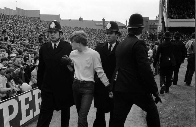 Soccer - Canon League Division One - Queens Park Rangers v Arsenal - Loftus Road Fans are led away by police after fighting broke out in the crowd   Date: 01/10/1983
