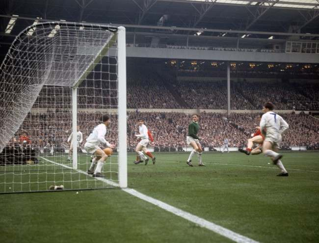 Liverpool's Ian St John (2nd right obscured, red shirt) scores an extra-time goal