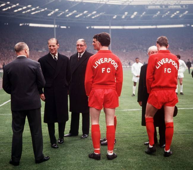 Liverpool football manager Bill Shankly (left, back to camera) is greeted by the Duke of Edinburgh (2nd left),