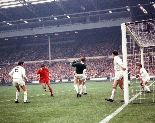 Leeds United goalkeeper Sprake (centre, green shirt) saves a header from Liverpool striker Hunt