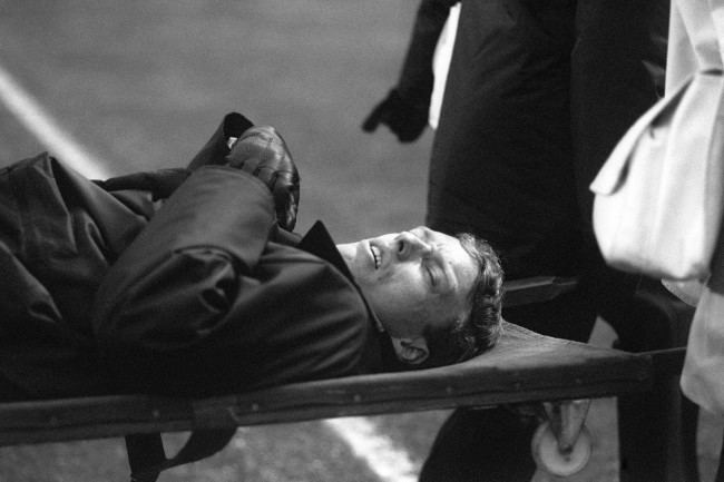 Soccer - FA Cup - Third Round - Arsenal v Millwall - Highbury An injured Policeman is stretchered away following crowd violence ahead of kick-off. Date: 09/01/1988