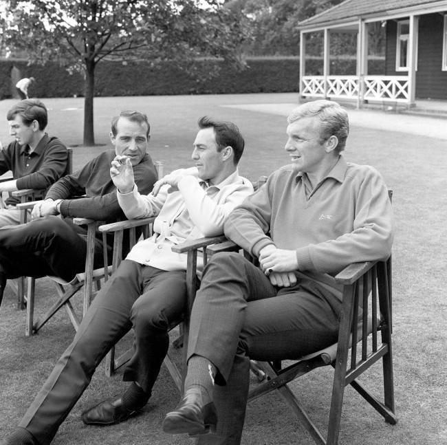 It can't be a fishing story, it might be the size of the hole in his injured leg. But whatever it is, Jimmy Greaves holds the attention of fellow England World Cup squad players Bobby Moore (right) and Ron Springett as they relax at Roehampton, London. Date: 29/07/1966