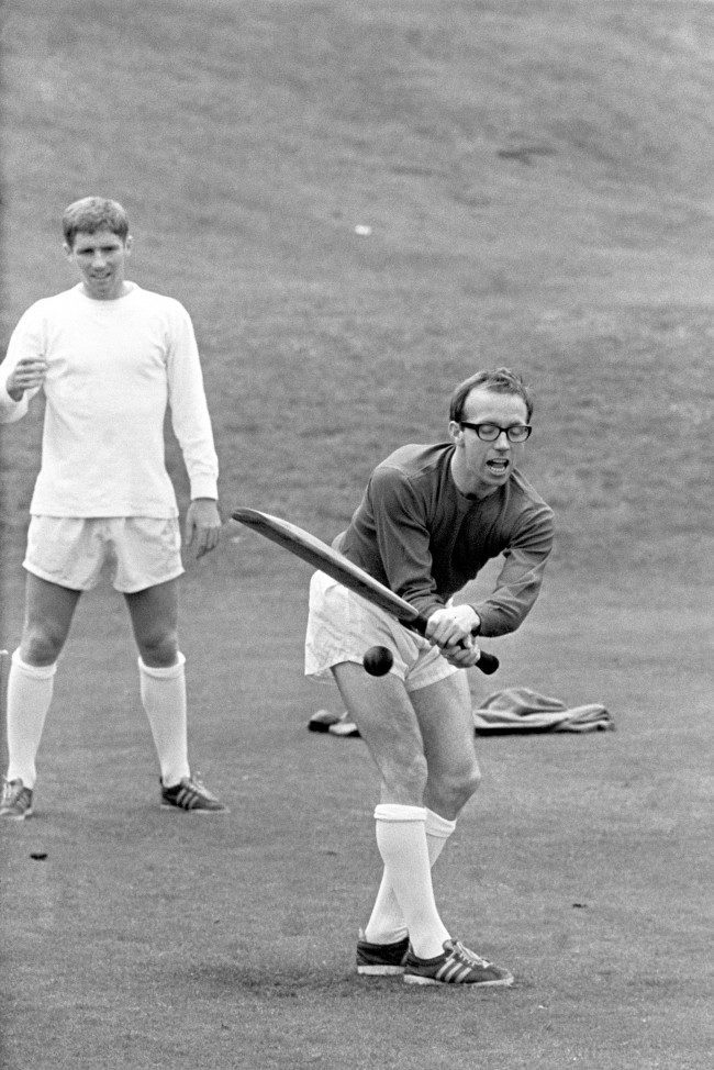 Nobby Stiles playing cricket, during England's World Cup team's preparation at Roehampton, London, before their semi-final match against Portugal at Wembley Stadium. Fielding in the picture is Alan Ball. Ref #: PA.1737871  Date: 25/07/1966