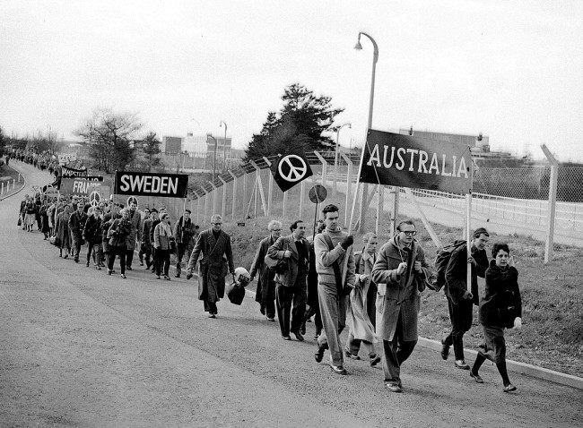"The Australian and Swedish contingents in the anti-H bomb march from the Atomic Weapons Researcg Establishment at Aldermaston, Berkshire, to London. Tens of thousands of people marked the end of the Aldermaston ""ban the bomb"" march with a rally in central London, when around 60,000 protesters gathered at Trafalgar Square (although organisers claimed the crowds numbered at least 100,000). This was the largest demonstration London had seen this century. Date: 27/03/1959"