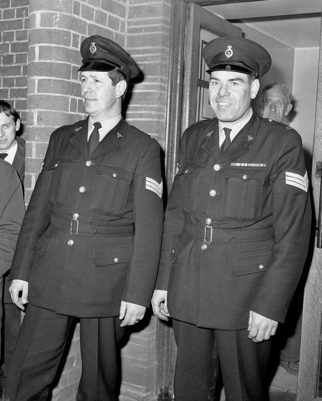 The police sergeants Peter Smith (left) and Oswald Thorne who found Harry Roberts in a storage hanger some 300 yards from Thornley Woods near Bishop Stortford, Hertfordshire. Date: 15/11/1966