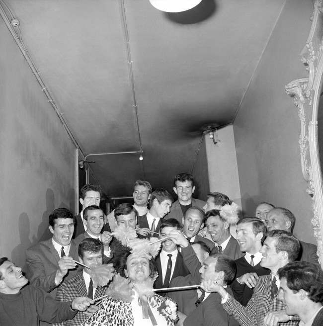 "Comedian Ken Dodd was in danger of being tickled to death at the London Palladium this evening when, on the eve of the FA Cup Final, the Liverpool team turned up to see the new Ken Dodd show, ""Doddy's here"". Ken Dodd himself a Liverpudlian, is a keen Liverpool supporter  Date: 30/04/1965"