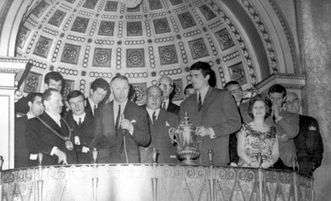Liverppol manager Bill Shankly addressing the guests who welcomed the Liverpool team at a civic reception at the Town Hall on their return to Liverpool after beating Leeds United in the Cup Final at Wembley. On left is the Lord mayor of Liverpool, Alderman Louis Caplan. Others in the photo are players Byrne, Stevenson, Smith, Lawler, Liverpool Chairman S. Reakes, Callaghan, Yeats (holding FA Cup, captain Ian St John, the Lady Mayoress fanny Bodker, Stevenson and T.V Williams, Preseident of Liverpool FC