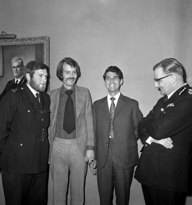 Commissioner of Police for the Metropolis, Sir Robert Mark (r) talks with the three police officers who are to receive bravery awards for protecting Princess Anne during the attempted kidnapping by Ian Ball. (l-r) PC Michael Hills receives the George Medal, Detective Constable Peter Edmonds is awarded the Queen's Gallantry Medal and Princess Anne's bodyguard, Inspector James Beaton is awarded the George Cross. 923-Archive-pa167112-6 Ref #: PA.19319415  Date: 05/07/1974